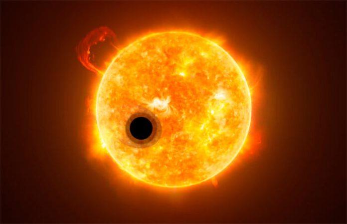 Interpretación artística del planeta superligero WASP-107b y su estrella, WASP-107